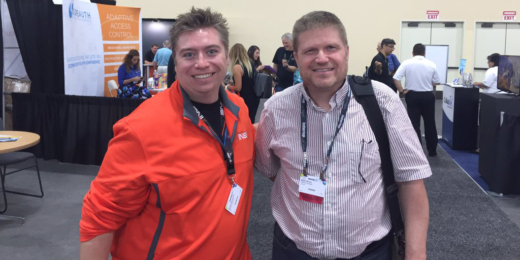 Brian McGahan having a blast chatting with an INE booth attendee at Interop 2016.