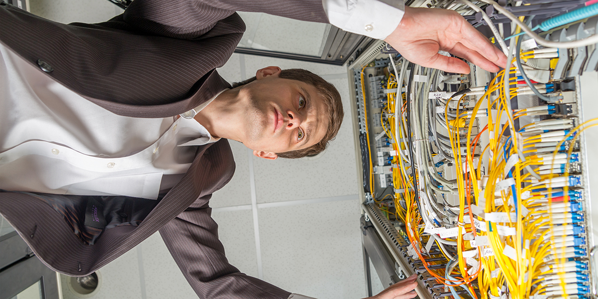 Network engineer working on a data center rack.
